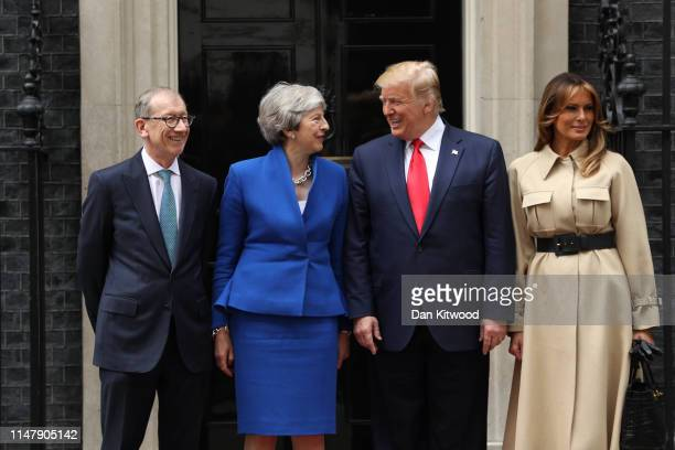 Philip May British Prime Minister Theresa May US President Donald Trump and First Lady Melania Trump arrive at 10 Downing street for a meeting on the...