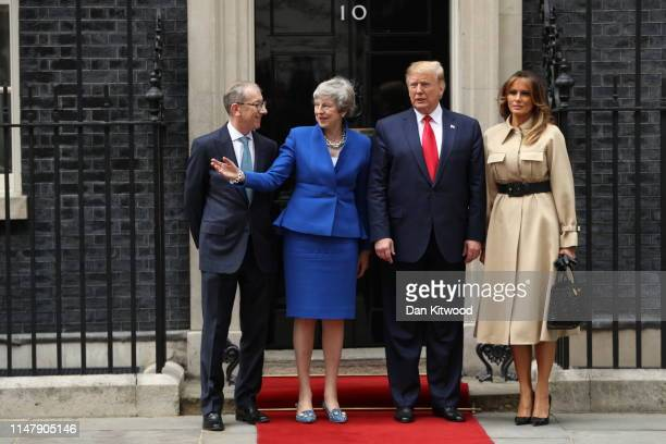 Philip May, British Prime Minister Theresa May, US President Donald Trump and First Lady Melania Trump arrive at 10 Downing street for a meeting on...