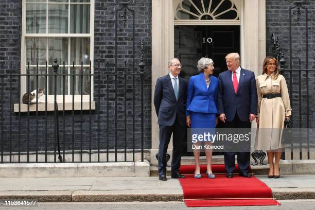 Philip May, British Prime Minister Theresa May, US President Donald Trump and First Lady Melania Trump arrive at 10 Downing street as Larry the Cat...