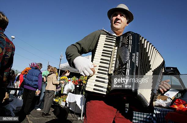 Philip Melancon plays an accordian at the Crescent City Farmers Market November 22, 2005. The market re-opened today for the first time since...