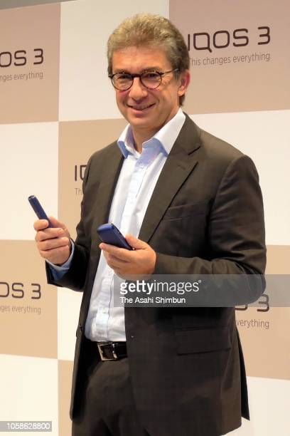 Philip Morris International Inc CEO Andre Calantzopoulos introduces new IQOS during a press conference on October 23 2018 in Tokyo Japan