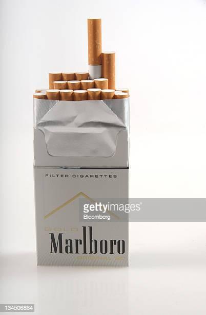 A Philip Morris International Inc Marlboro cigarette packet is arranged for a photograph in Melbourne Australia on Wednesday Nov 23 2011 Australia is...
