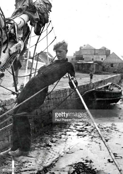 Philip Mountbatten later Prince Philip Duke of Edinburgh pictured in the rigging of the Gordonstoun sailtraining vessel Prince Louis during his time...