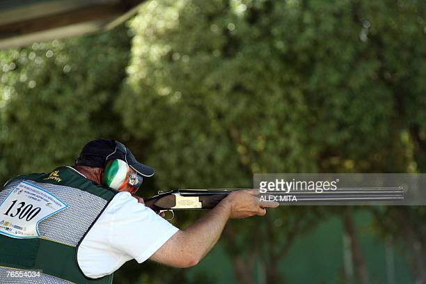 Philip Murphy of the Republic of Ireland prepares to fire during men's trap final of the ISSF World Shooting Championships held in Nicosia Murphy won...