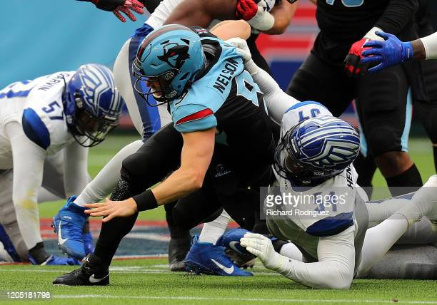 Philip Nelson of the Dallas Renegades gets sacked by Dewayne Hendrix of the St Louis Battlehawks in an XFL football game on February 09 2020 in...