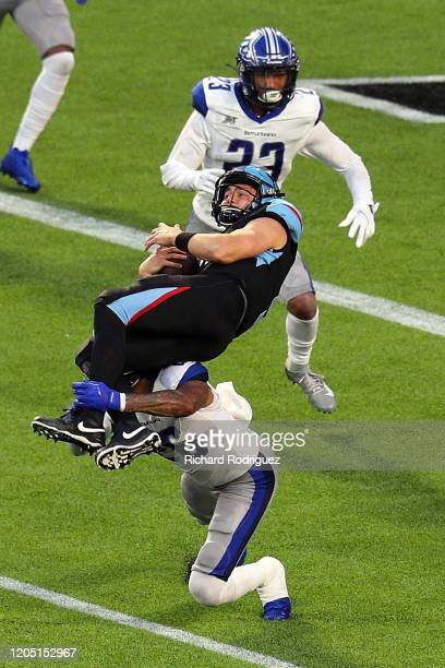 Philip Nelson of the Dallas Renegades gets upended by Dexter McCoil of the St. Louis Battlehawks in the third quarter at an XFL Game on February 09,...
