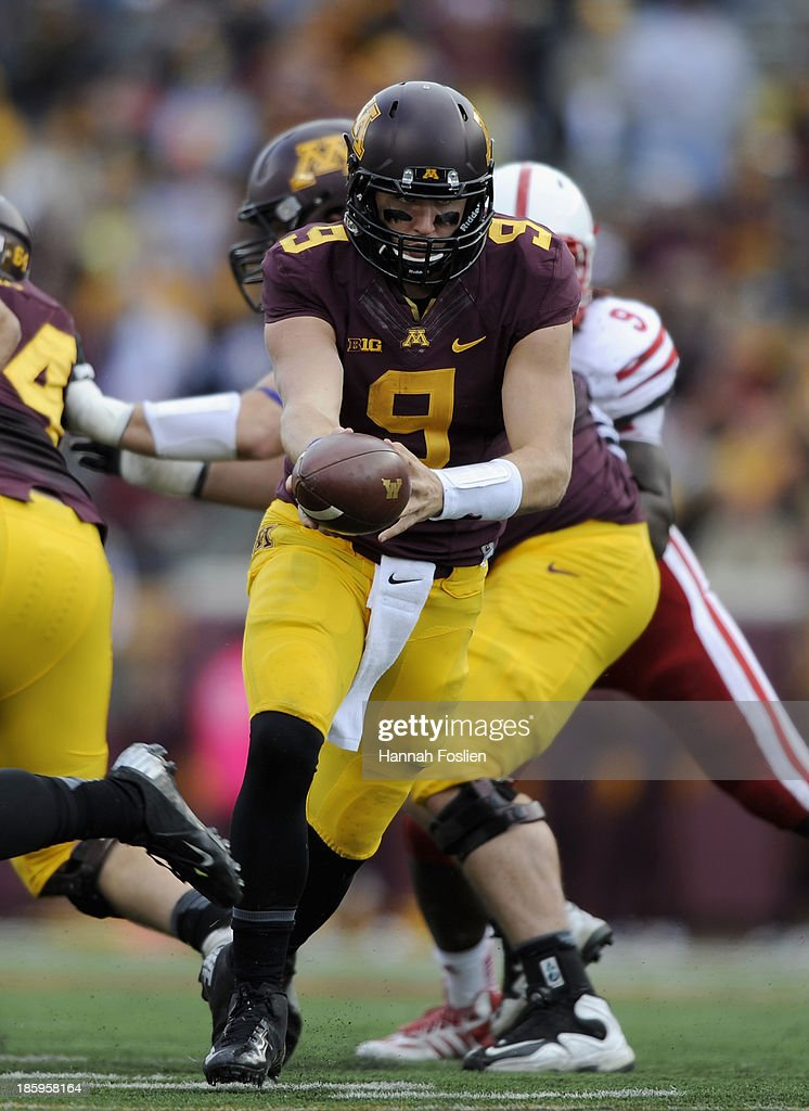 Philip Nelson #9 of the Minnesota Golden Gophers looks to hand off the ball during the fourth quarter of the game against the Nebraska Cornhuskers on October 26, 2013 at TCF Bank Stadium in Minneapolis, Minnesota. The Golden Gophers defeated the Cornhuskers 34-23.