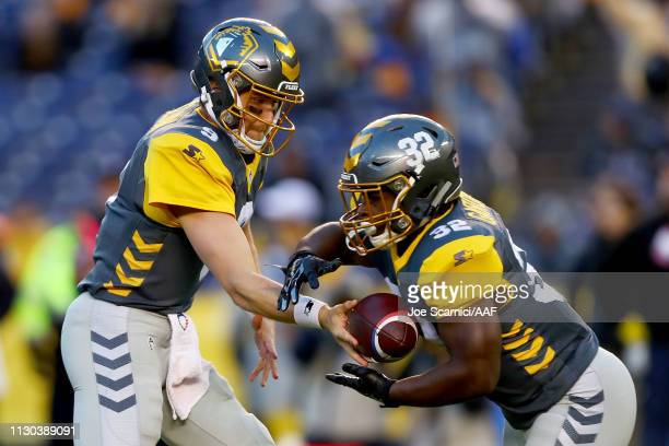 Philip Nelson of the San Diego Fleet hands the ball off to Ja'Quan Gardner in the first quarter against the Atlanta Legends during the Alliance of...