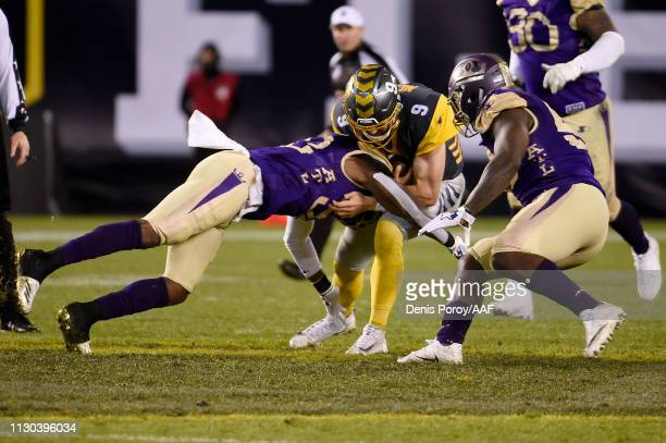 Philip Nelson of the San Diego Fleet runs with the ball while being tackled by Tyson Graham Jr #32 of the Atlanta Legends in the second quarter...
