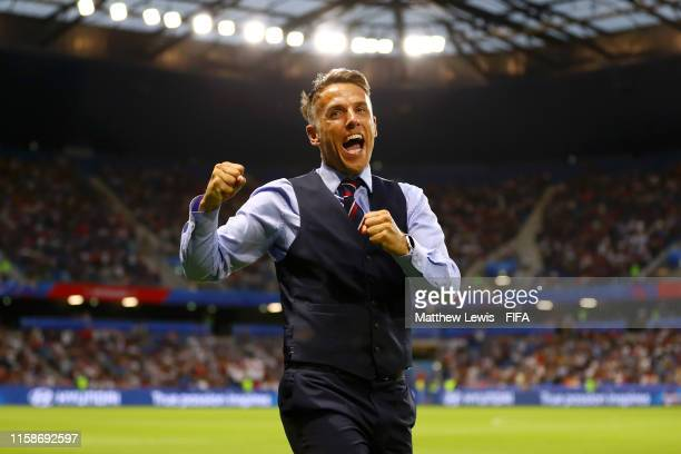 Philip Neville Head Coach of England celebrates after his team's third goal during the 2019 FIFA Women's World Cup France Quarter Final match between...