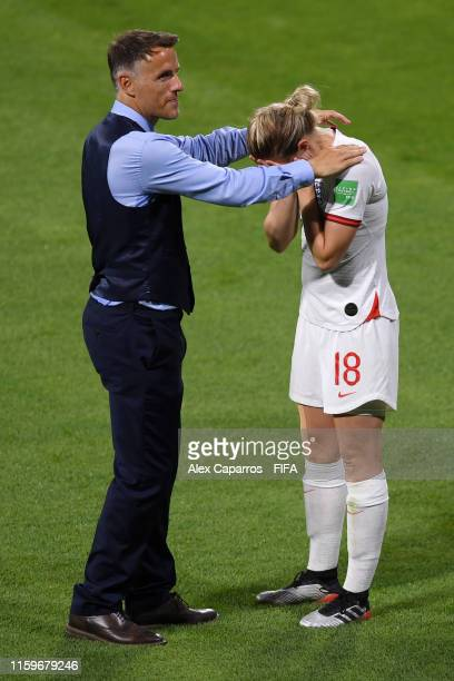 Philip Neville Head Coach of England consoles Ellen White following the 2019 FIFA Women's World Cup France Semi Final match between England and USA...