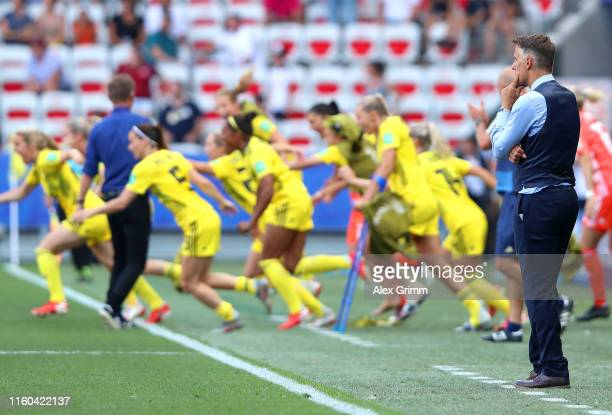 Philip Neville, Head Coach of England looks on as the Sweden players celebrate following Sweden's victory in the 2019 FIFA Women's World Cup France...