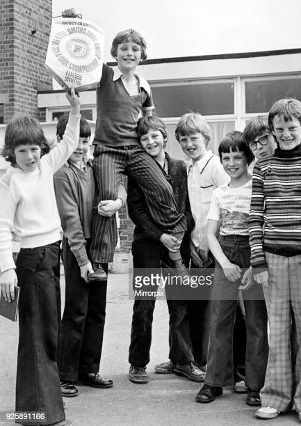 Philip Parkinson the captain of St Patrick's RC Primary School Stockton is hoisted shoulder high by his team mates with the English football schools'...