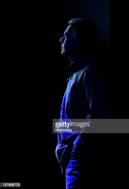 Philip Phil Schiller senior vice president of worldwide marketing at Apple Inc watches a video during an event in San Francisco California US on...