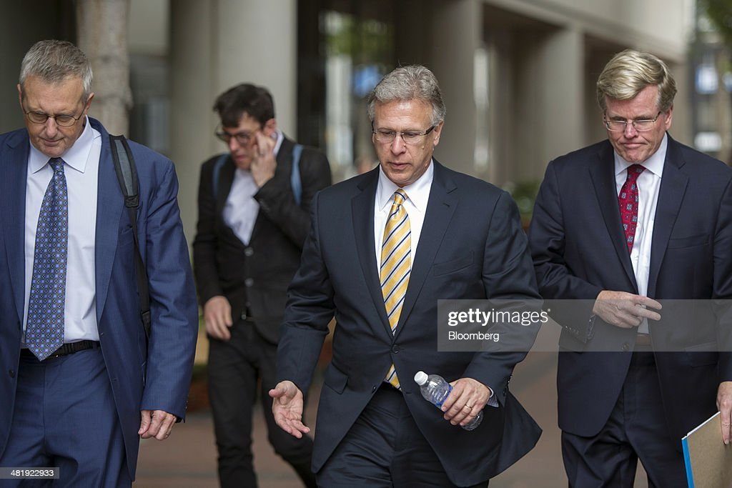 Philip 'Phil' Schiller, senior vice president of worldwide marketing at Apple Inc., center, exits the Robert Peckham United States Federal Court Building in San Jose, California, U.S., on Tuesday, April 1, 2014. Samsung Electronics Co. told jurors at the opening of a $2 billion trial that Apples patent case is really an attack on Google Inc.s Android operating system and a ploy to stem smartphone competition that has overwhelmed iPhone sales. Photographer: David Paul Morris/Bloomberg via Getty Images