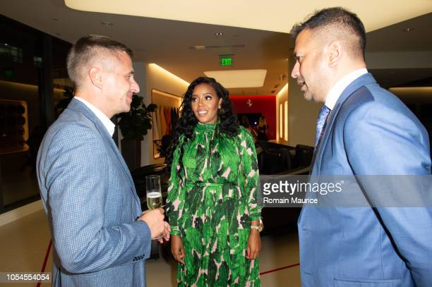 Philip Raum Angela Simmons and Kamal Hotchandani Attend Cybex For Scuderia Ferrari Launch Party on October 12 2018 in Miami Florida