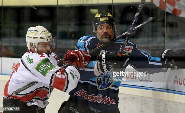 Philip Riefers of Koeln and Tyler Bouck of Ingolstadt battle for the puck in game six of the DEL final playoffs between ERC Ingolstadt and Koelner...