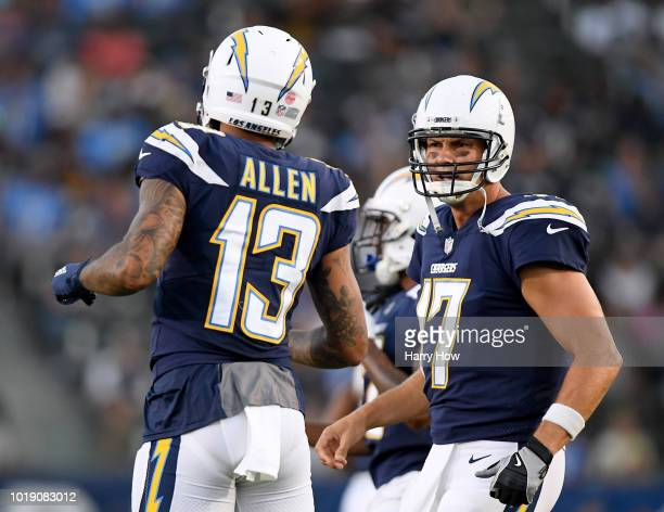 Philip Rivers and Keenan Allen of the Los Angeles Chargers talk as they take the field during a presseason game against the Seattle Seahawks at...