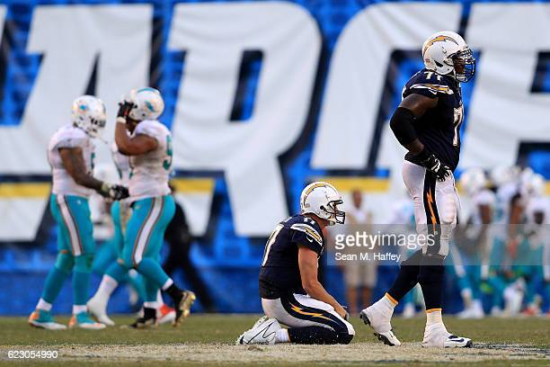 Philip Rivers and King Dunlap of the San Diego Chargers look on after an interception during the second half of a game against the Miami Dolphins at...