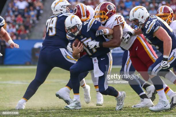 Philip Rivers of the Los Angeles Chargers being sacked by Kevin Bowen of the Washington Redskins during a NFL game between the Washington Redskins...
