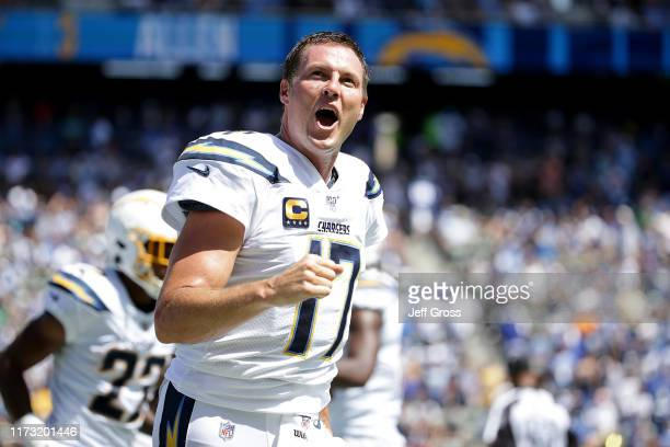Philip Rivers of the Los Angeles Chargers celebrates after passing for a touchdown in the second quarter against the Indianapolis Colts at Dignity...