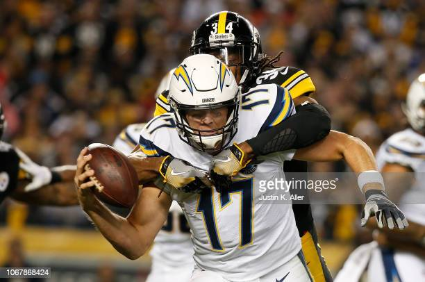 Philip Rivers of the Los Angeles Chargers is wrapped up for a sack by Terrell Edmunds of the Pittsburgh Steelers in the first half during the game at...