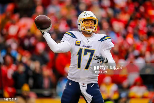 Philip Rivers of the Los Angeles Chargers looks for an open receiver during the third quarter against the Kansas City Chiefs at Arrowhead Stadium on...