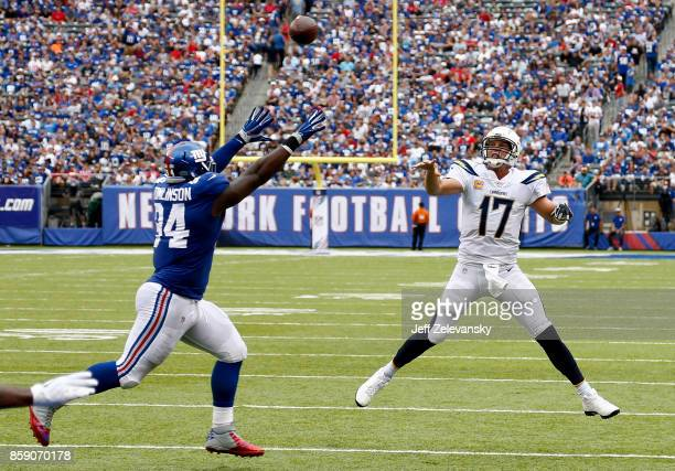 Philip Rivers of the Los Angeles Chargers passes over Dalvin Tomlinson of the New York Giants during their game at MetLife Stadium on October 8 2017...