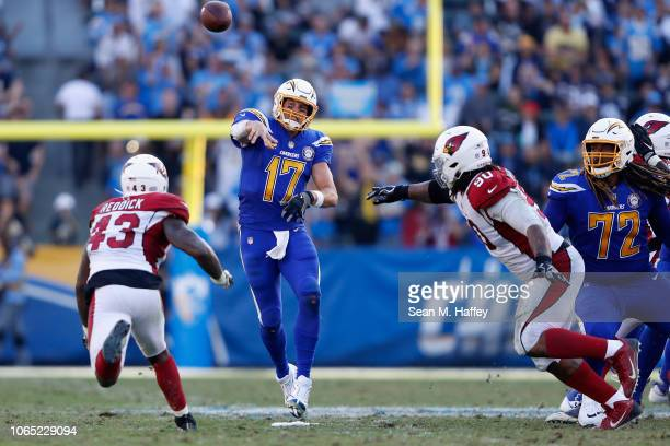 Philip Rivers of the Los Angeles Chargers passes the ball under pressure from Robert Nkemdiche and Haason Reddick of the Arizona Cardinals during the...