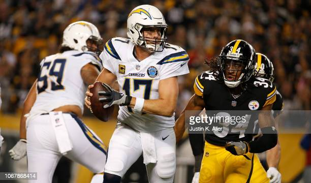 Philip Rivers of the Los Angeles Chargers scrambles under pressure from Terrell Edmunds of the Pittsburgh Steelers in the first half during the game...