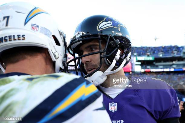 Philip Rivers of the Los Angeles Chargers shakes hand with Joe Flacco of the Baltimore Ravens after the AFC Wild Card Playoff game at MT Bank Stadium...