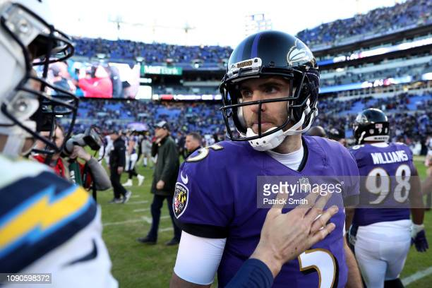 Philip Rivers of the Los Angeles Chargers talks with Joe Flacco of the Baltimore Ravens after the AFC Wild Card Playoff game at MT Bank Stadium on...