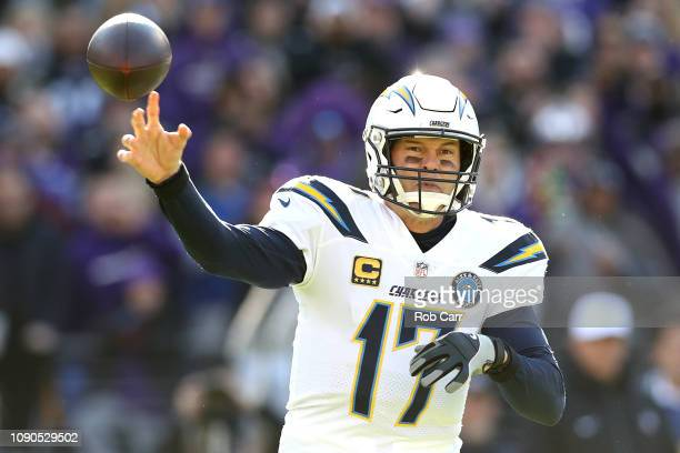 Philip Rivers of the Los Angeles Chargers throws a pass against the Baltimore Ravens during the first quarter in the AFC Wild Card Playoff game at MT...