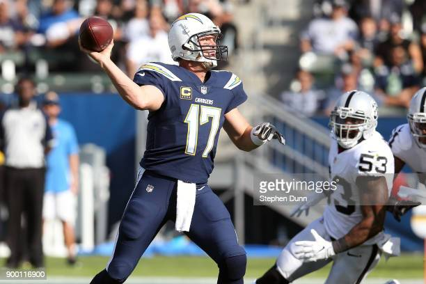 Philip Rivers of the Los Angeles Chargers throws a pass against the Oakland Raiders during the first quarter of the game at StubHub Center on...