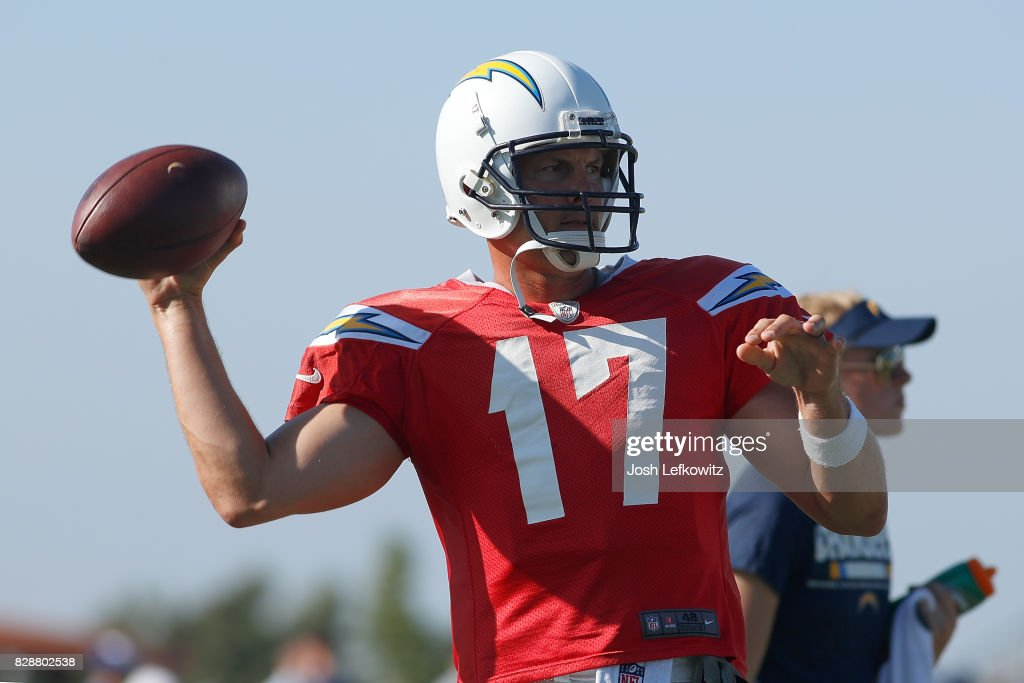 Philip Rivers #17 of the Los Angeles Chargers throws a pass during a combined practice with the Los Angeles Rams at Crawford Field on August 9, 2017 in Irvine, California.
