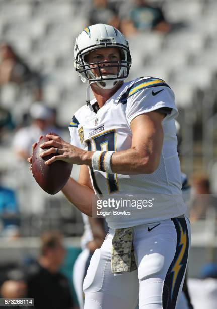 Philip Rivers of the Los Angeles Chargers warms up on the field prior to the start of their game against the Jacksonville Jaguars at EverBank Field...