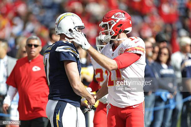 Philip Rivers of the San Diego Charger and Alex Smith of Kansas City Chiefs chat with one another during warm ups during a NFL game at Qualcomm...