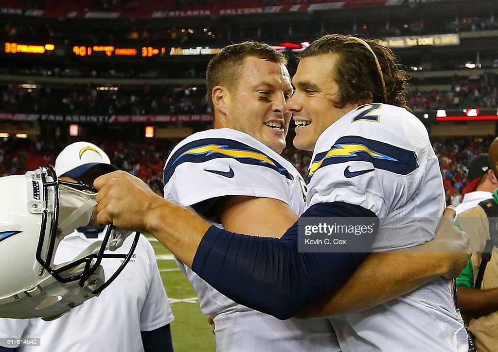 Philip Rivers #17 of the San Diego Chargers celebrates with Josh Lambo #2 after Lambo's game-winning field goal in a 33-30 overtime win over the Atlanta Falcons at Georgia Dome on October 23, 2016 in Atlanta, Georgia.
