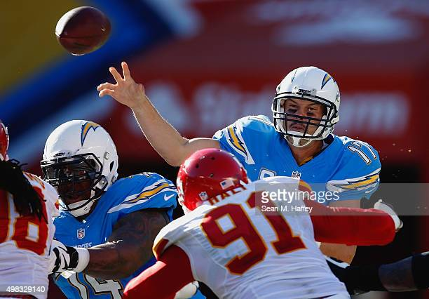 Philip Rivers of the San Diego Chargers passes the ball under pressure from Tamba Hali of the Kansas City Chiefs during the second half of a game at...