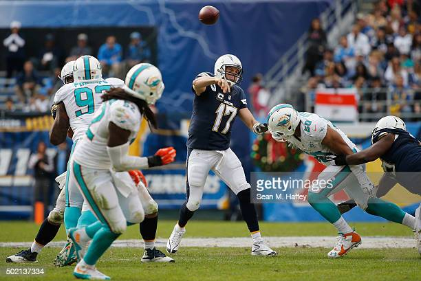 Philip Rivers of the San Diego Chargers passes the ball under pressure from Miami Dolphins defensive end Olivier Vernon of the Miami Dolphins during...
