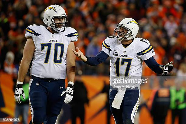 Philip Rivers of the San Diego Chargers reacts with Jeffrey Linkenbach during the fourth quarter of a game against at Sports Authority Field at Mile...