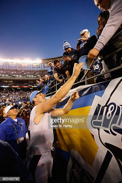 Philip Rivers of the San Diego Chargers signs fans memorabilia after the San Diego Chargers defeated the Miami Dolphins 3014 at Qualcomm Stadium on...