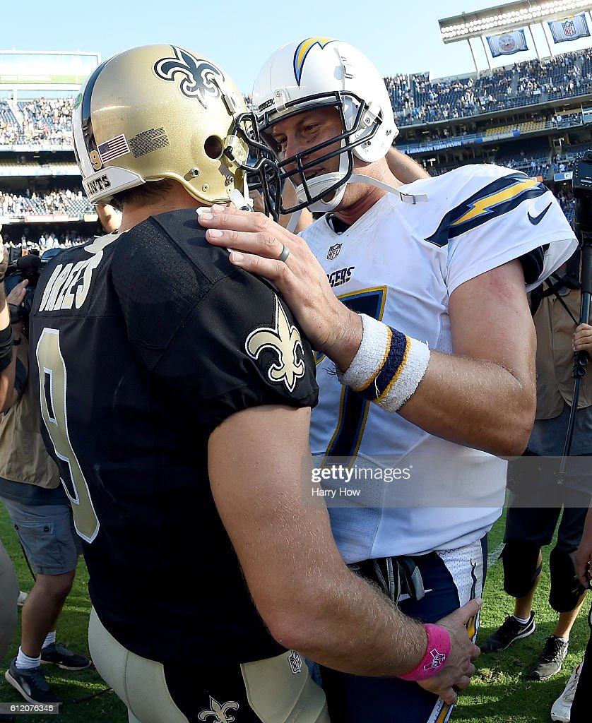 Philip Rivers #17 of the San Diego Chargers speaks with Drew Brees #9 of the New Orleans Saints after a 35-34 come from behind Saints win at Qualcomm Stadium on October 2, 2016 in San Diego, California.