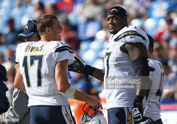 Philip Rivers of the San Diego Chargers talks to King Dunlap during NFL game action against the Buffalo Bills at Ralph Wilson Stadium on September...