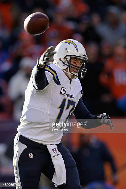 Philip Rivers of the San Diego Chargers throws a pass against the Denver Broncos during the AFC Divisional Playoff Game at Sports Authority Field at...