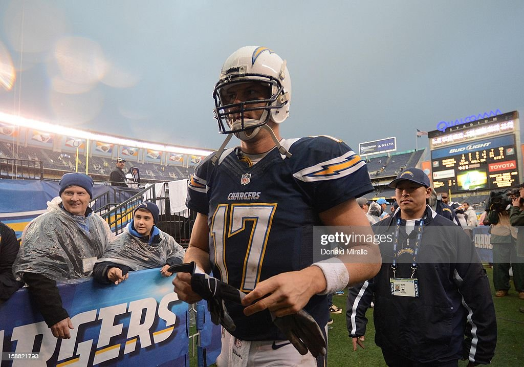 Philip Rivers #17 of the San Diego Chargers walks back to the locker room after the 24-21 win over the Oakland Raiders on December 30, 2012 at Qualcomm Stadium in San Diego, California.