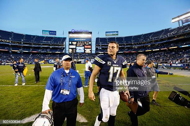 Philip Rivers of the San Diego Chargers walks off after the San Diego Chargers defeated the Miami Dolphins 3014 at Qualcomm Stadium on December 20...