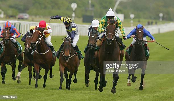 Philip Robinson and Rakti lead the field home to land The Juddmonte Lockinge Stakes Race run at Newbury Racecourse on May 14 2005 in Newbury England