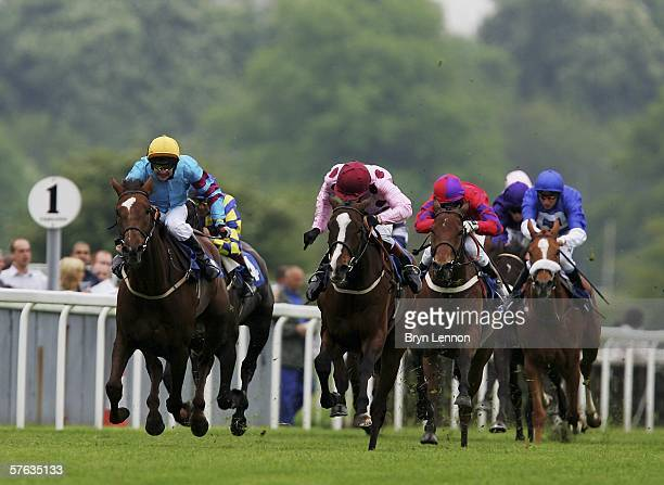 Philip Robinson riding Millville leads the field on his way to winning The Blue Square Stakes race at York Racecourse on May 17 York England