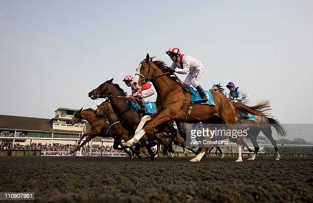 Philip Robinson riding Nideeb win The Sportingbet Supports HEROS Winter Derby at Lingfield racecourse on March 26 2011 in Lingfield England